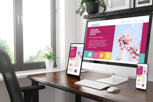 Black and white desktop with three devices showing awesome responsive design 3d rendering